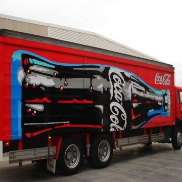 A red truck with Coke Cola graphics