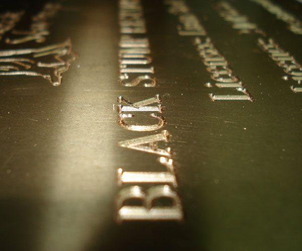 Close up of an engraved brass plaque
