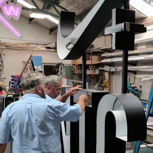 Signkiosk staff fabricating a sign