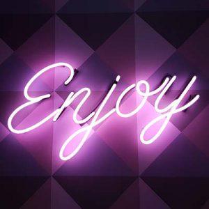 Neon sign saying Enjoy
